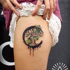 cool tree of watercolor on thigh by cynthia sobraty