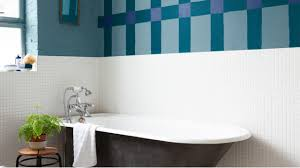 paint over bathroom tiles i love the chandelier over the bathtub