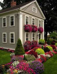 small lanscaping ranch house design with beautiful various flower