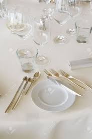 laid table at luxury restaurant with glasses plate and cutlery