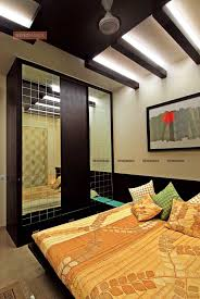make a small bedroom look bigger renomania wooden full height cupboards with mirror shutters bedroom ceiling design