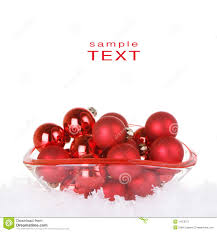 ornaments in glass bowl with snow stock image