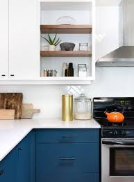 this home received an updated kitchen with blue cabinets and white