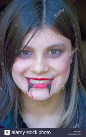 11 year old wearing vampire makeup for a halloween party