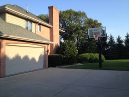 Building A 2 Car Garage by A Driveway Wider Than A 2 Car Garage Surely Has Enough Room To