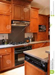 kitchen wooden furniture kitchen wood cabinets black and stainless stove stock photo
