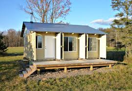 man builds cozy tin can cabin out of shipping containers in