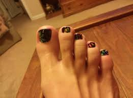 my new toe nails neon background with flowers outlined with black