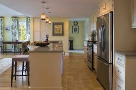 stainless fridge and wall picture plus kitchen floor tile in