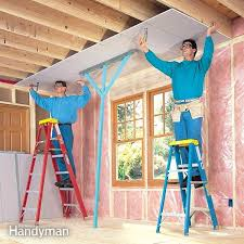 install cabinets like a pro the family handyman how to hang drywall like a pro the family handyman