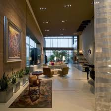 living room art rug art high ceiling massive modern home in