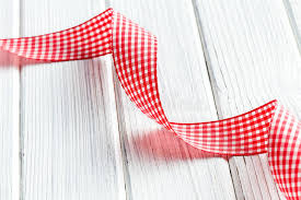 checkered ribbon checkered ribbon on white wooden table stock image image 29334903
