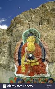 giant buddha witting mural rock stone wall paint hill mountain leh giant buddha witting mural rock stone wall paint hill mountain leh ladakh india
