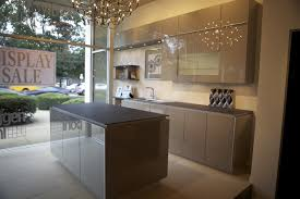 grey kitchen cabinets with white appliances glass door stainless