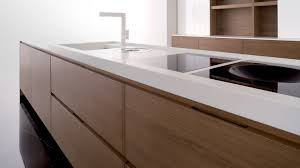 furniture white corian countertop with double sink and faucet