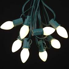 white ceramic c7 outdoor string light set on green wire novelty