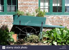 barrow style handcart used as a decorative planter in a large
