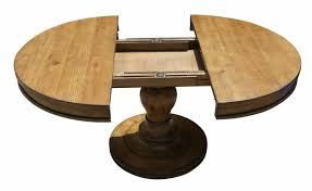 black wooden round pedestal dining room table with carved base