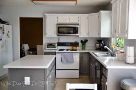 painted kitchen cabinets before and after what does she do all day kitchen after painted cabinets grey and white diy