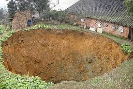 Sinkhole In Backyard Family U0027s Crater Escape As Huge Sinkhole Appears Next To Home