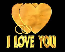 golden heart rings images Golden heart rings and i love you text on black background stock jpg