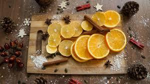 ornaments on wood background orange and lemon slices on
