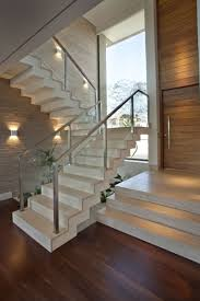 contemporary staircase with modern interior railing high ceiling
