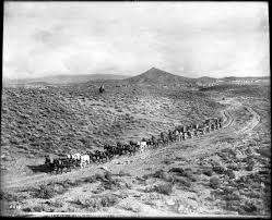 Nevada traveling images File a long stagecoach traveling down an unpaved dirt road towards jpg