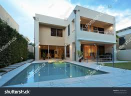 luxurious modern house swimming pool backyard stock photo