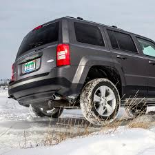 jeep patriot lifted off road in the snow with jeep