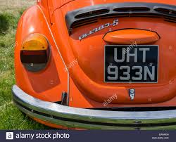orange volkswagen beetle classic orange volkswagen beetle at volksfest bristol stock photo