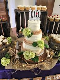 wedding cake and cupcakes rustic wedding cake and cupcake display