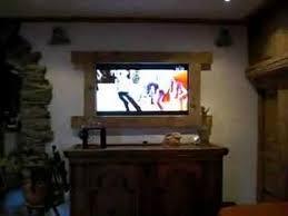 hidden tv behind painting youtube