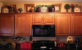 top of kitchen cabinet decor ideas how to decorate top of kitchen cabinets pinterest joelglasserhomes com