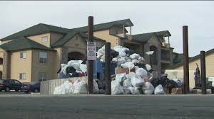 Trash House by Illegal Dumping Causing Trash Trouble For Denver Homeowners
