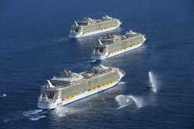 three royal caribbean cruise ships meet at sea