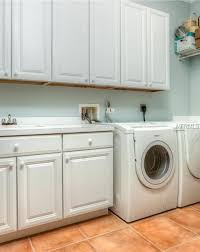 traditional laundry room with built in bookshelf terracotta tile