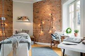 Decorating With String Lights 10 Ways To Decorate An Exposed Brick Wall Without Drilling 6sqft