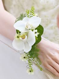 white wrist corsage orchid fern wrist corsage