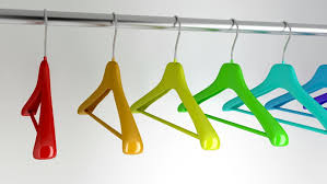 hangers with different colors in the closet stock footage video