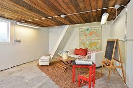 Pb Comfort Sofa Rustic Basement By Bill Charman Zillow Digs Zillow