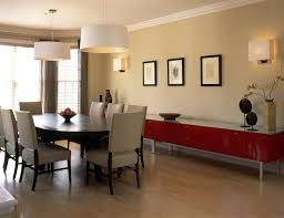 small dining room designed with wainscoting and red walls feature