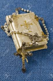 communion book holy communion rosary and religious book on blue background