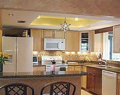 cathedral ceiling kitchen lighting ideas changing the kitchen fluorescent box light fixtures like the use