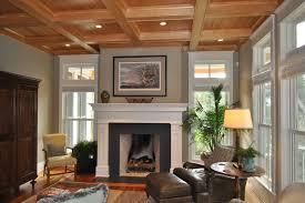 granite fireplace surround family room traditional with area rug armoire ceiling