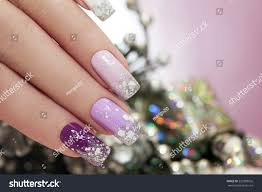 lilac nail polish sparkles snowflakes on stock photo 229388026