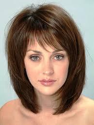 medium hairstyles for wavy hair with bangs women medium haircut
