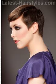 cropped hairstyles with wisps in the nape of the neck for women polished smooth pixie cut hair is combed forward and flat with