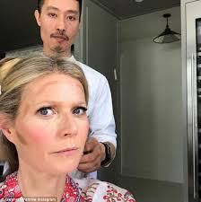 makeup artist in la gwyneth paltrow looks confused at makeup artist s contouring