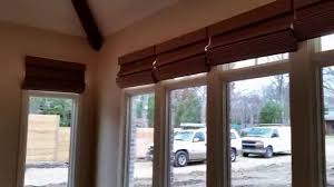 installation of motorized roman shades by vista products powered